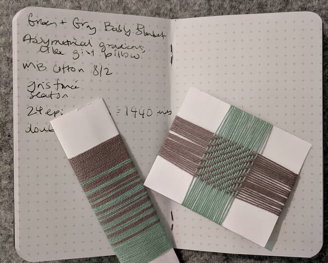 A notebook and two cards wrapped with sample weaving yarns